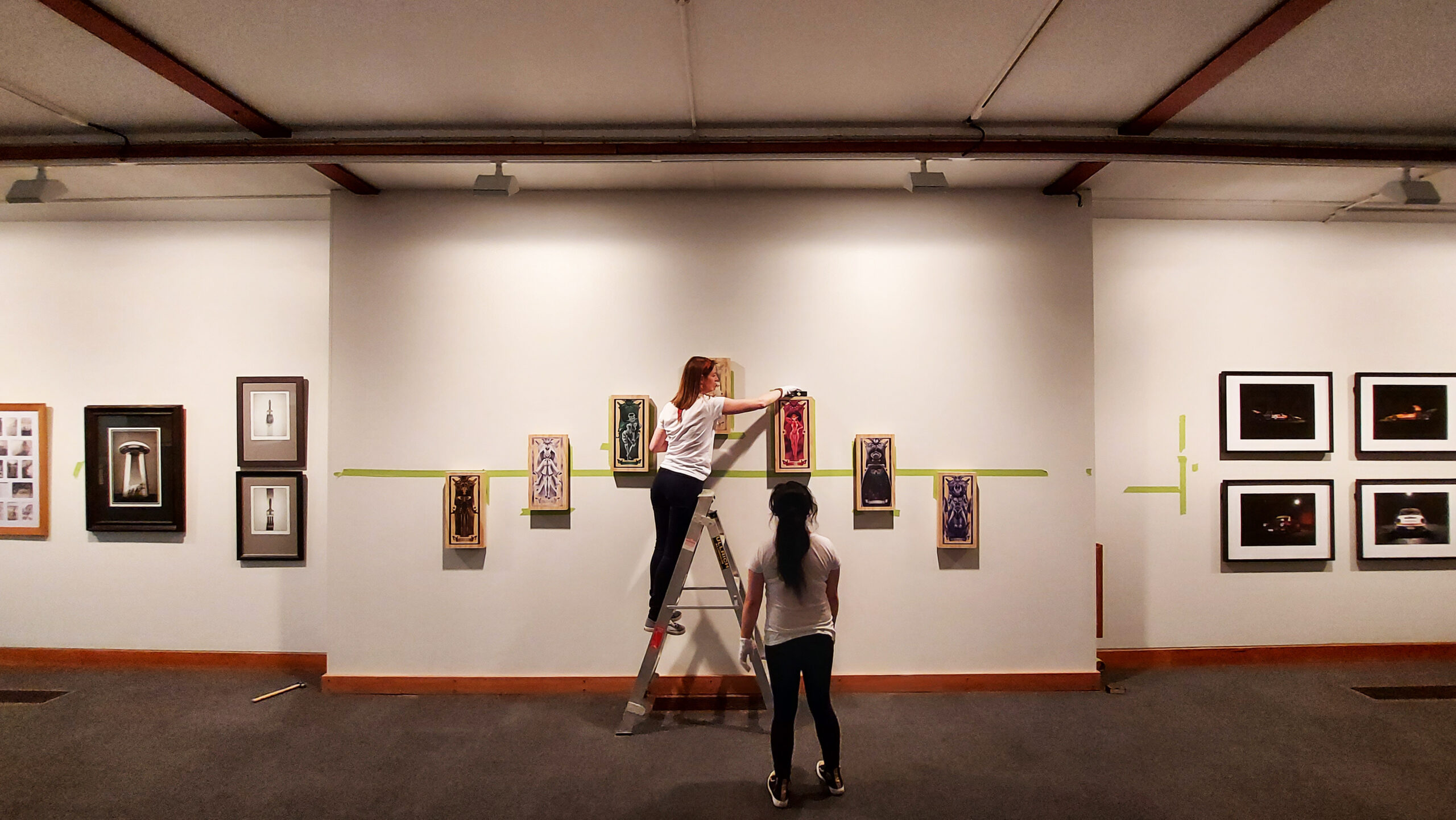 Technicians install paintings in the Art Gallery
