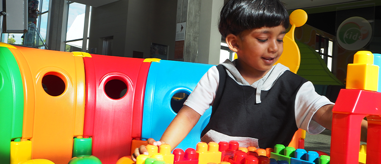 A child plays with brightly coloured toys