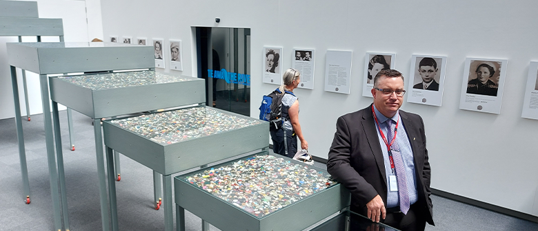 Chris Harris, chief executive of the Holocaust Centre of New Zealand, stands with the memorial
