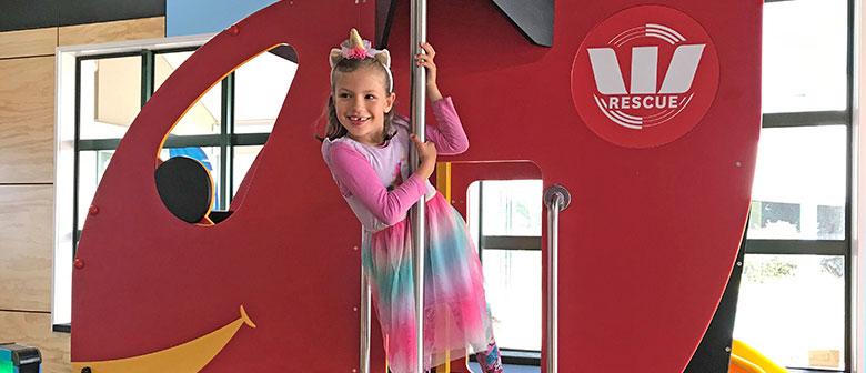 Child plays in exhibition playground