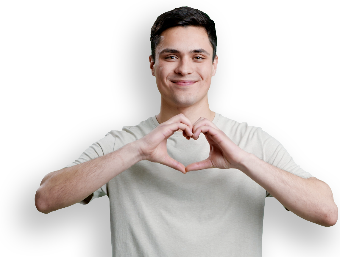 Young man makes heart symbol with his hands on a clear background