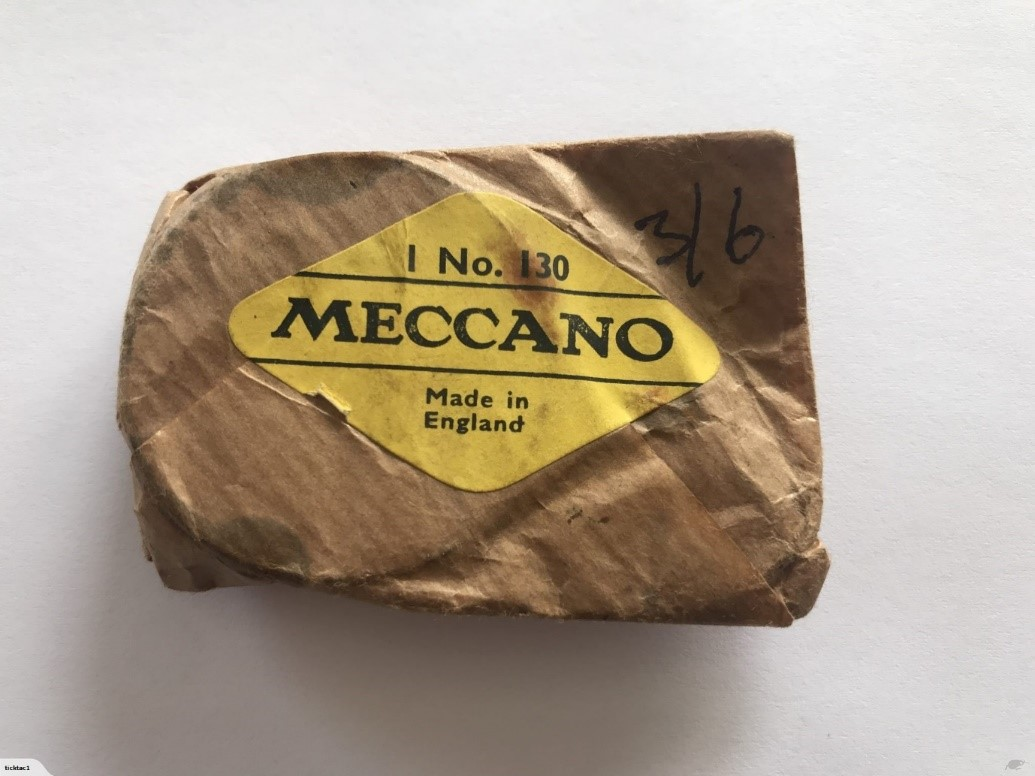 A vintage Meccano package - brown paper with yellow label