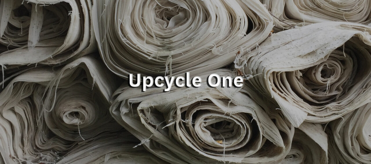 Event title: Upcycle One with piles of old fabric