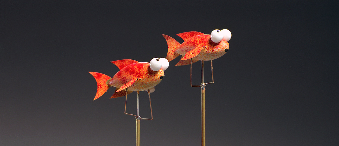Two goldfish on metal rods