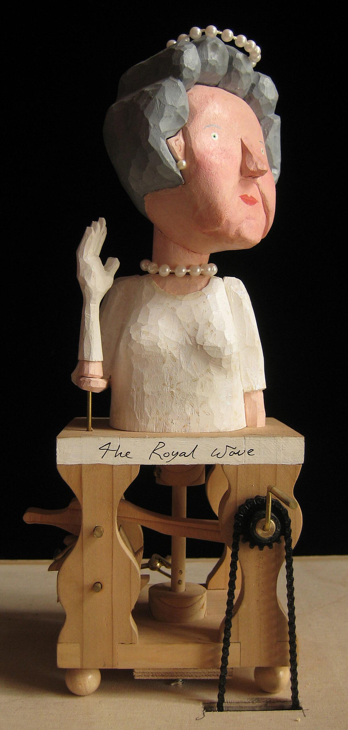 A mechanical wooden sculpture of the Queen