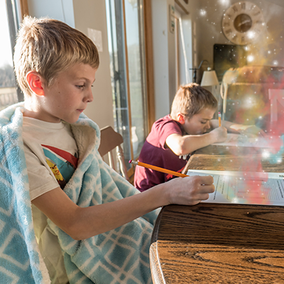 Photo of two young boys doing homework